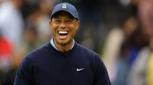 Tiger Woods laughs at a recent tournament.