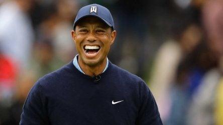 Tiger Woods laughs at a recent tournament.