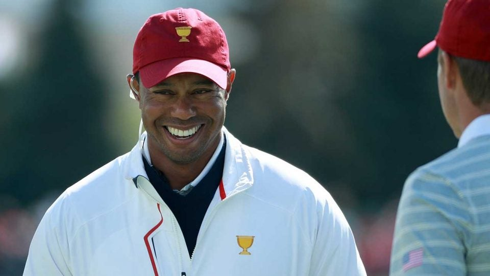Tiger Woods laughs during the 2017 Presidents Cup. Woods was an assistant captain that year, but he'll call the shots in 2019.