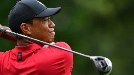 Tiger Woods watches a tee shot.