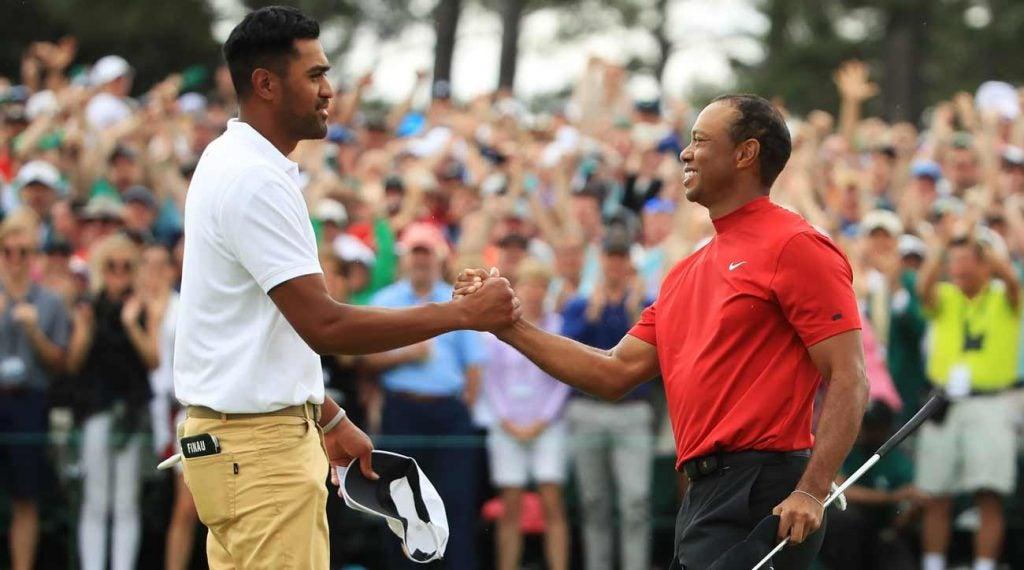 Tony Finau congratulates Tiger Woods on winning the 2019 Masters.