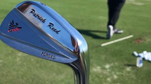 Patrick Reed's custom irons have his name and foundation logo on the head.