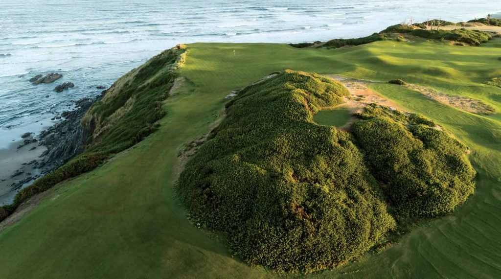 Views from the verdant dune include the greens for Nos. 3 and 16. The tee box for No. 4 sits atop it.