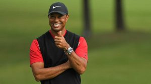 Tiger Woods smiles after winning the Zozo Championship in October.