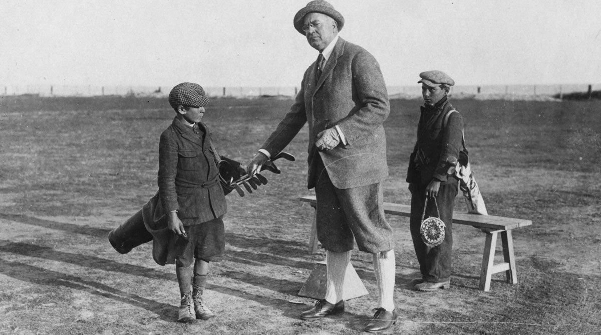 A golfer and his bagman — well, bagboy —circa 1922.