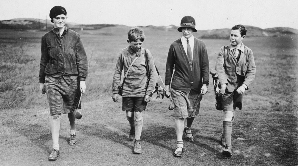 A pair of young caddies on the job, pictured in 1929.