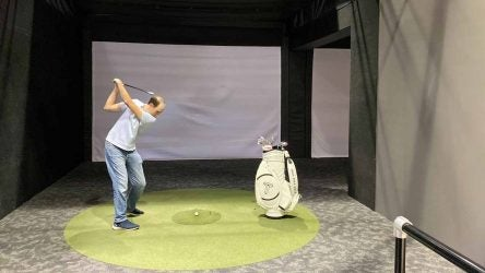 Warming up prior to a club fitting at True Spec Golf's New York City location.
