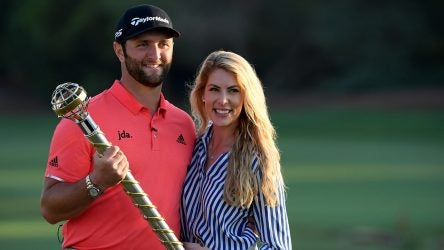 Jon Rahm and Kelley Cahill pose for a picture after Rahm won the DP World Tour Championship on Nov. 24 in Dubai.