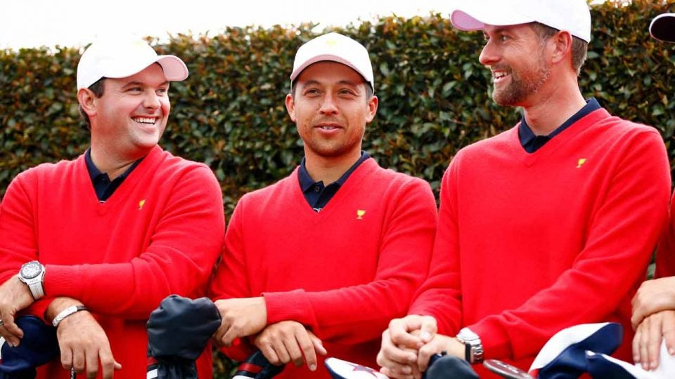 U.S> Presidents Cup team mmembers Patrick Reed, Xander Schauffele (center) and Webb Simpson (right) pose for photos yesterday at Royal Melbourne.