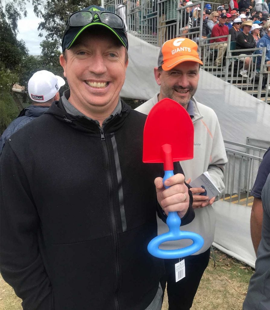 Patrick Reed heard it from several fans on Thursday, including this one who bought a shovel for the occasion.