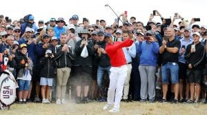 Tiger Woods hits an approach shot during the first session of the Presidents Cup on Thursday.