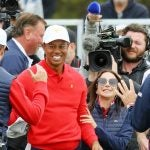 Tiger Woods and his U.S. teammates celebrate during Sunday singles at the Presidents Cup on Sunday at Royal Melbourne in Australia.