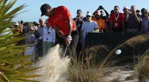 Tiger Woods hits out of a waste area during the 2016 Hero World Challenge.