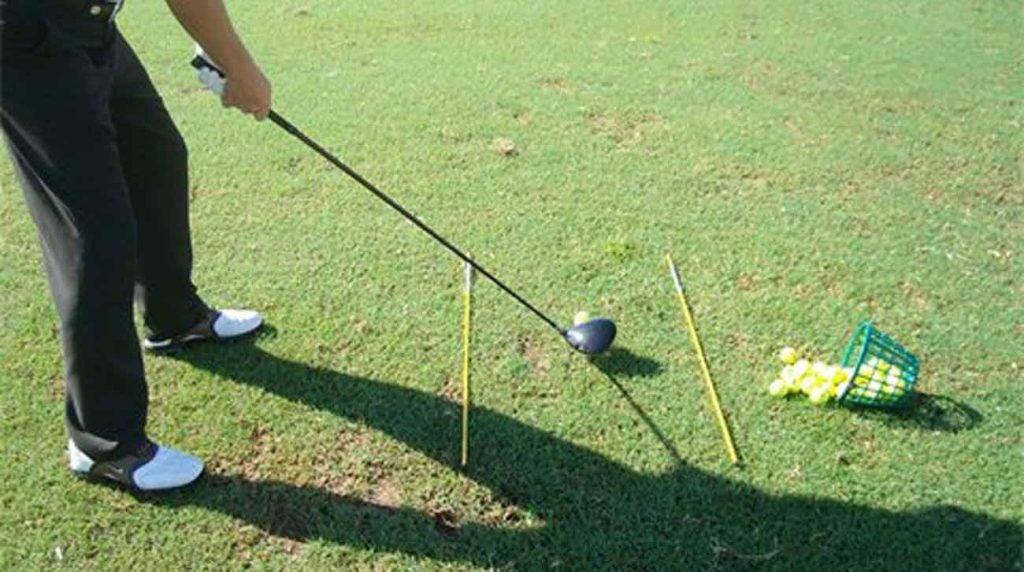 alignment sticks on range