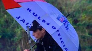Joaquin Niemann borrowed a rules official's umbrella, only once his umbrella was broken.