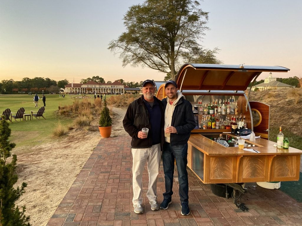 My dad and I enjoying a drink at The Cradle's mobile bar to end a Pinehurst golf trip