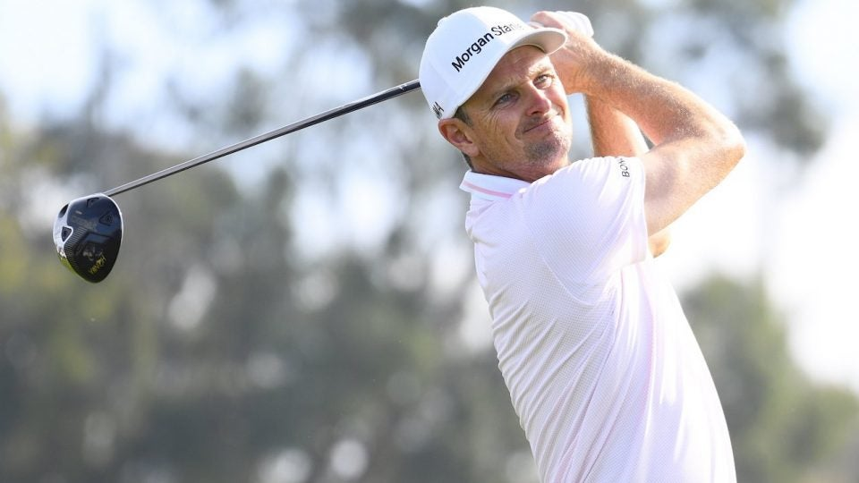 Justin Rose watches a tee shot.