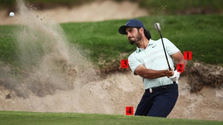 Abraham Ancer blasts out of a bunker at the Australian Open.