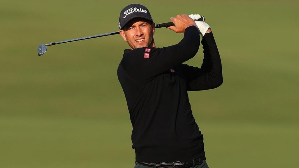 Adam Scott finishes his swing at the Australian Open.