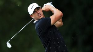 Brooks Koepka finishes his swing at the Tour Championship.