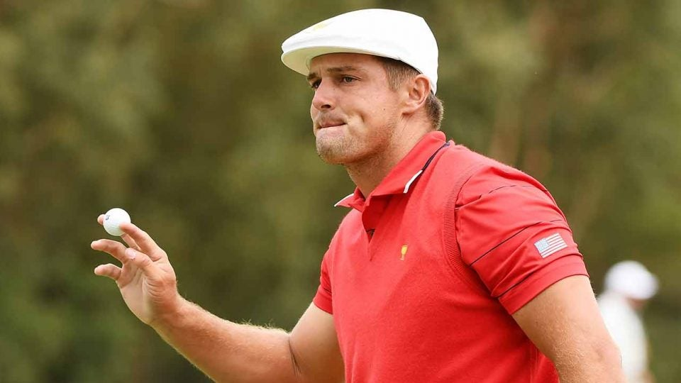 Bryson DeChambeau waves to the crowd at the Presidents Cup.