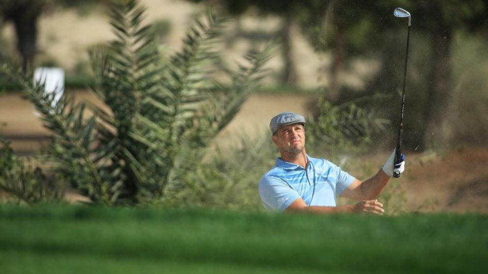 Bryson DeChambeau attempts to escape the rough Thursday at the Dubai Desert Classic