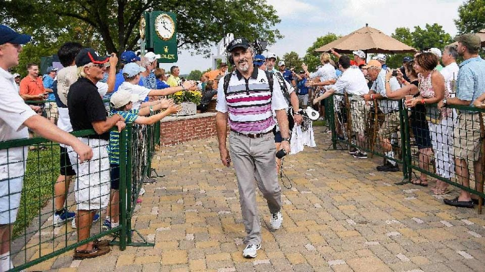 David Feherty takes a walk to the next tee during a broadcast.