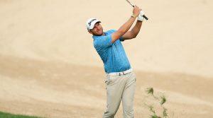 Dean Burmester hits an approach during the Dubai Desert Classic.
