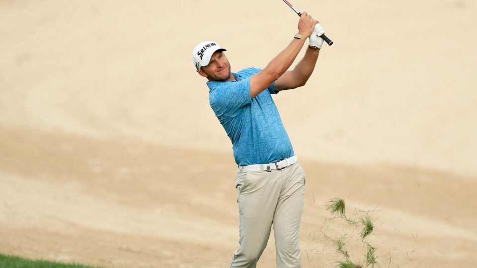 Dean Burmester hits an approach during the Dubai Desert Classic.