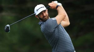 Dustin Johnson tees off during a practice round at the 2020 Tournament of Champions.