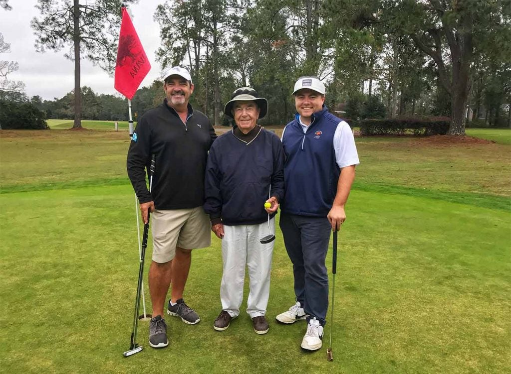 Gramps (middle) is flanked by one of his sons, former tour player Ben Bates (left), and the author.