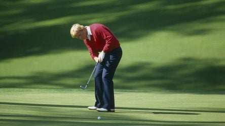 Jack Nicklaus hits a putt at the Masters.