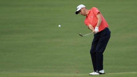 Justin Thomas hits a chip shot at the Sony Open.