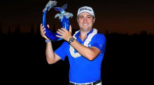 Justin Thomas poses for photos after winning the 2020 Tournament of Champions.