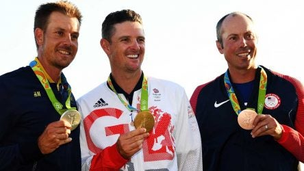 Henrik Stenson, Justin Rose and Matt Kuchar pose with their Olympic medals.