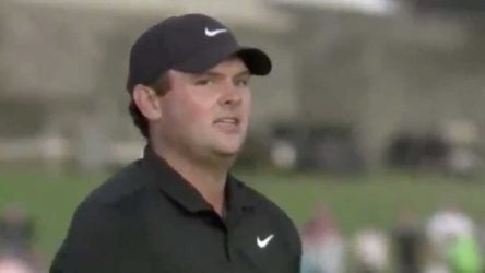 Patrick Reed glares at a fan in the crowd during the playoff.