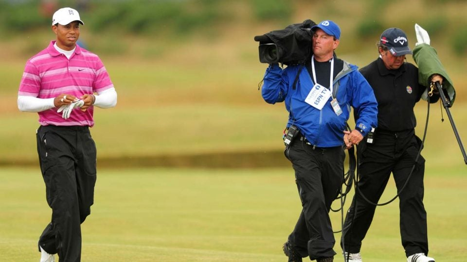 An ESPN camerman follows Tiger Woods at the 2010 Open Championship at St. Andrews