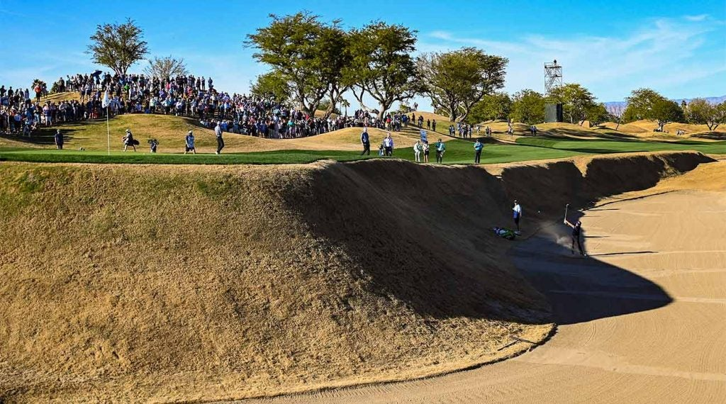 Phil Mickelson blasts out of the massive bunker left of the green on the 16th hole of PGA West's Stadium Course.