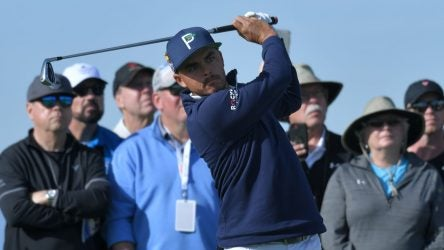 Rickie Fowler tees off at the Farmers Insurance Open.