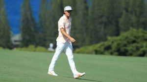 Rickie Fowler walks down the fairway at the Sentry Tournament of Champions. Fowler tied for 5th.