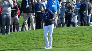 Rickie Fowler hits a chip shot at the Farmers Insurance Open.