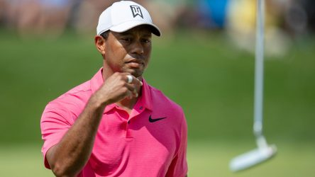 Tiger Woods tosses his putter at the Memorial Tournament.