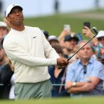 Tiger Woods chips onto the green during the second round of the Farmers Insurance Open on Friday at Torrey Pines.