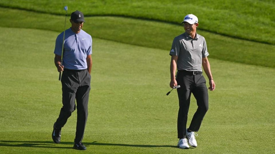 Tiger Woods and Collin Morikawa talk during the opening round at the 2020 Farmers Insurance Open