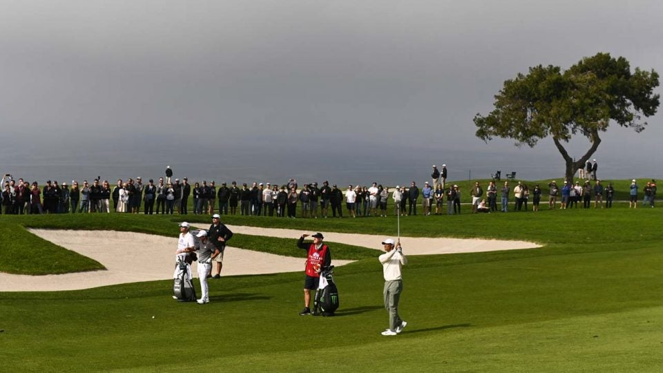 Tiger Woods plays the fifth hole on Torrey Pines' South Course on Friday.