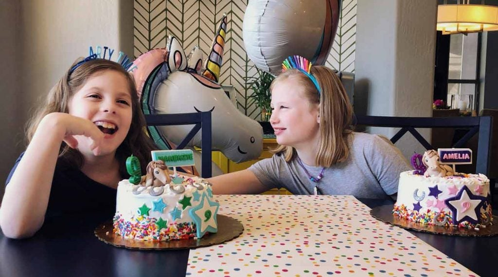 Amelia and Makenzie Kahn celebrate their 9th birthday together.