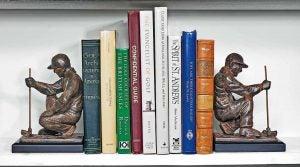 Golf books on bookshelf