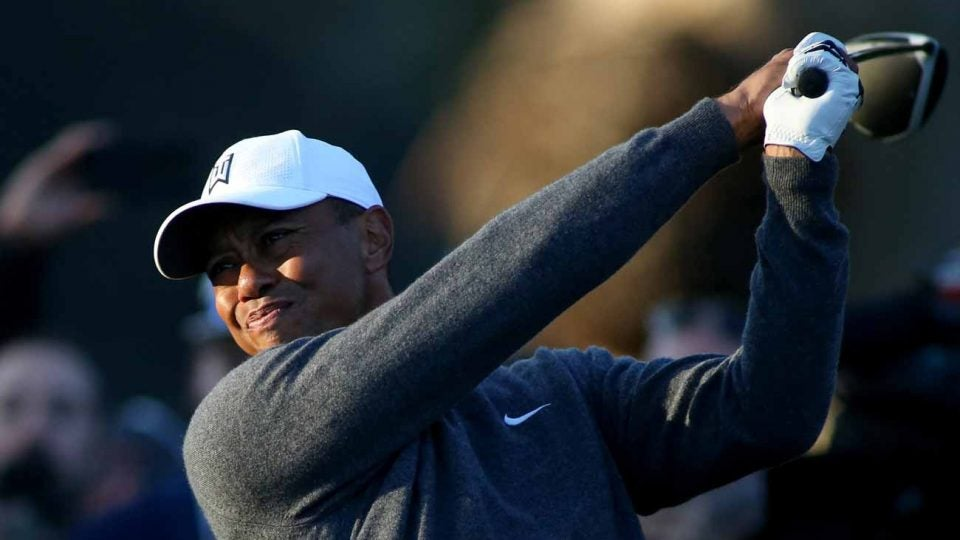 Tiger Woods tees off during the second round of the Genesis Invitational on Friday.