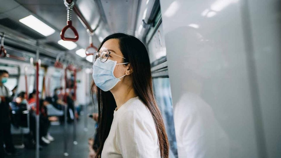 A woman in Hong Kong wears a mask to protect against the coronavirus.