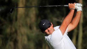 Patrick Reed hits a shot during Thursday's first round of the Mexico Championship.